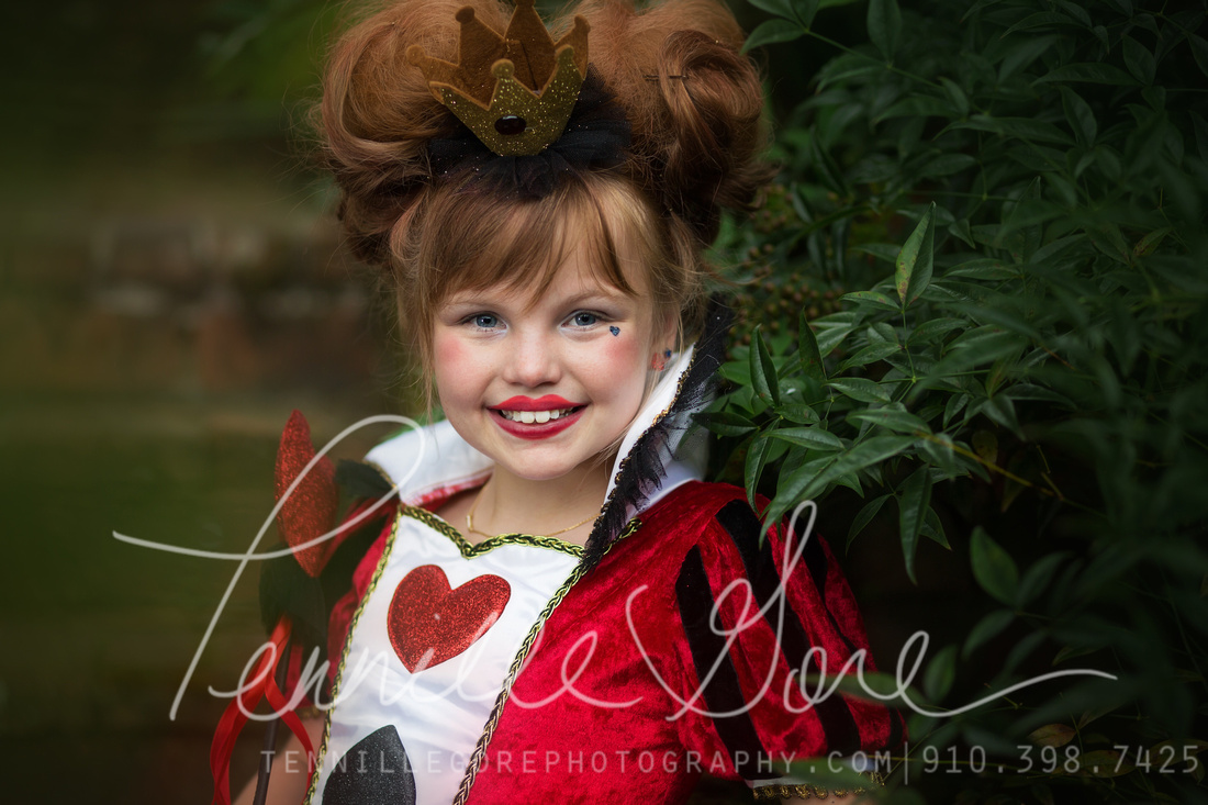 Young girl dressed as the Queen of Hearts, Photographed on location at The Burgwin Wright House in Wilmington,, NC.