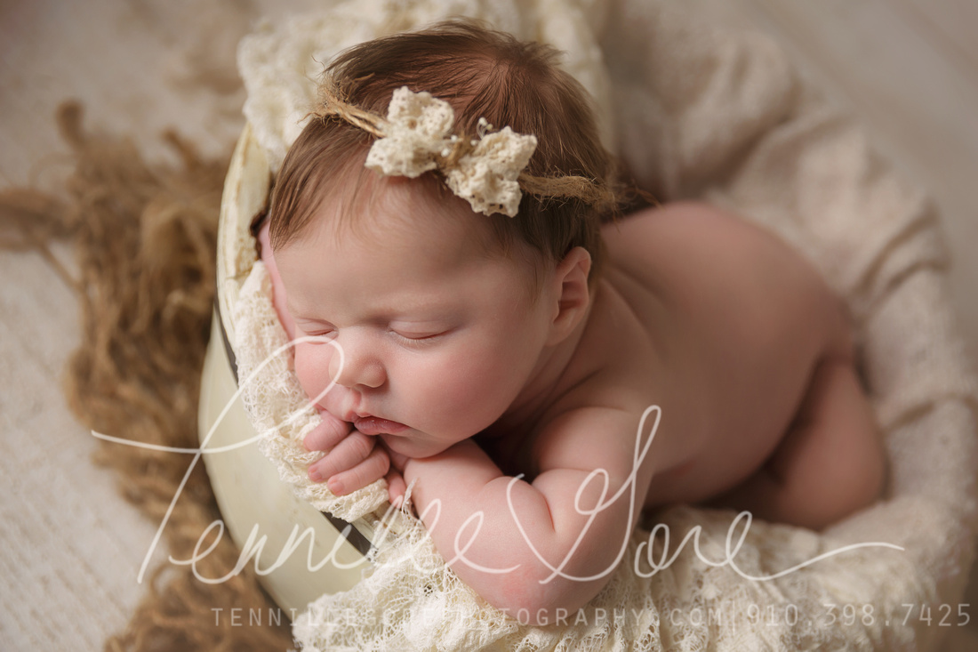 17 days new baby girl in bucket with lace and burlap tieback